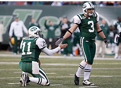 Nov 29, 2009; East Rutherford, NJ, USA; New York Jets quarterback Kellen Clemens (11) and New York Jets PK Jay Feely (3) celebrate Feely's field goal during the second half at Giants Stadium. The Jets defeated the Panthers 17-6.
