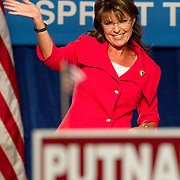 Former Alaska governor Sarah Palin waves to the crowd after speaking at the Republican Victory 2010 Fundraising Rally in Orlando, Florida October 23, 2010. REUTERS/Scott Audette   (UNITED STATES)