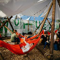 People relaxing in hammocks at Flow Festival 2013.