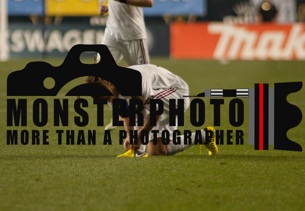 Real Salt Lake Midfielder Kyle Beckerman (5) ties his shoe during a MLS regular season match against The Philadelphia UnionFriday, Aug. 24, 2012. at PPL Park in Chester PA..
