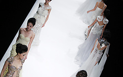 A model presents a creation by Chinese designer Zhang Jingjing's haute couture collection during the China Fashion Week in Beijing, China, 30 October 2012. The Mercedes-Benz China Fashion Week will run from 24 October to 3 November.