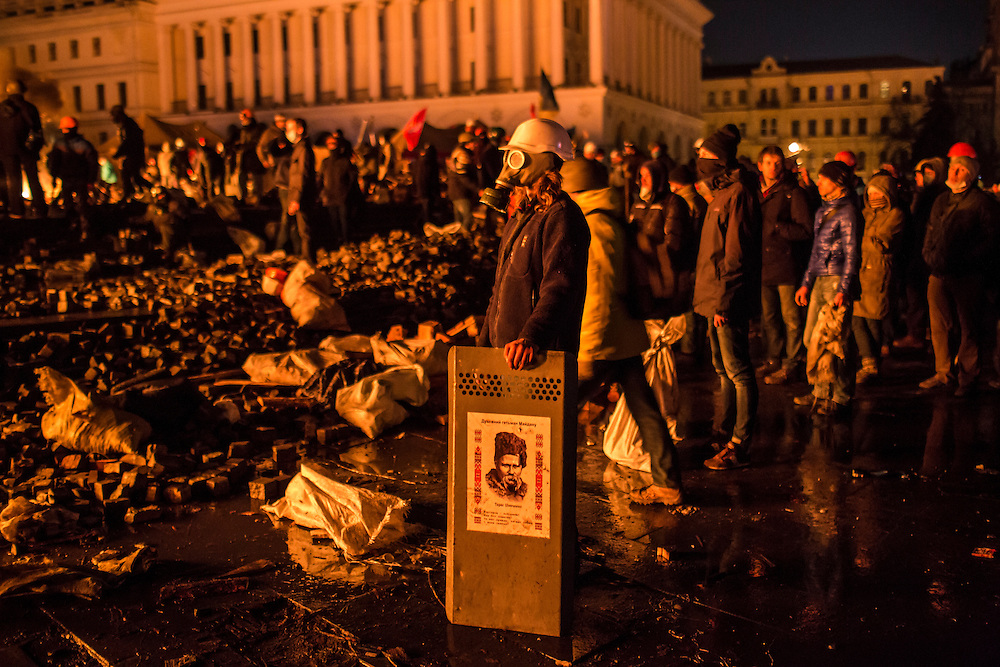 KIEV, UKRAINE - FEBRUARY 19: Anti-government protesters guard the perimeter of Independence Square, known as Maidan, on February 19, 2014 in Kiev, Ukraine. After several weeks of calm, violence has again flared between police and anti-government protesters, who are calling for the ouster of President Viktor Yanukovych over corruption and an abandoned trade agreement with the European Union. (Photo by Brendan Hoffman/Getty Images) *** Local Caption ***