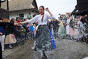 Water spraying ritual, traditional costumes and folk traditions at Easter Festival in Hollókő, UNESCO World Heritage-listed village in the Cserhát Hills of the Northern Uplands, Hungary.