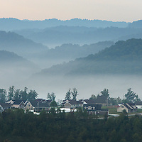 September 17, 2009. Hazard, Kentucky. Morning fog rises out of the valleys behind a housing subdivision near a surface coal mine. (Credit image: © David Stephenson/ZUMA Press)