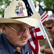 DES MOINES, IA - JUNE 14: Richard Hoffman of Grinnell, Iowa protests Democratic presidential hopeful Sen. Hillary Clinton as they hold a rally for second amendment  freedoms Sunday, June 14, 2015, during a campaign rally for Clinton at the Iowa State Fairgrounds in Des Moines, Iowa. Scott Morgan for The New York Times
