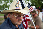 DES MOINES, IA - JUNE 14: Richard Hoffman of Grinnell, Iowa protests Democratic presidential hopeful Sen. Hillary Clinton as they hold a rally for second amendment  freedoms Sunday, June 14, 2015, during a campaign rally for Clinton at the Iowa State Fairgrounds in Des Moines, Iowa. (Scott Morgan/for The New York Times)