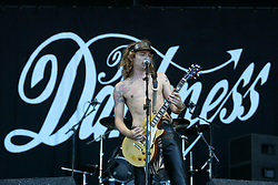 Justin Hawkins of The Darkness, opening Sunday at the Main Stage, on Sunday 13th July, 2003 at T in the Park..Pic ©2010 Michael Schofield. All Rights Reserved.