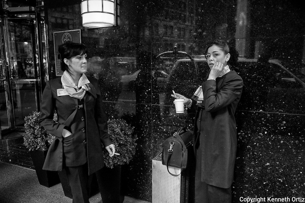 Two Egyptian stewardesses taking a smoke break outside of their hotel in New York City.