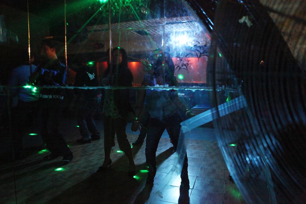 Filipino women enjoying their Saturday evening at a dance club.