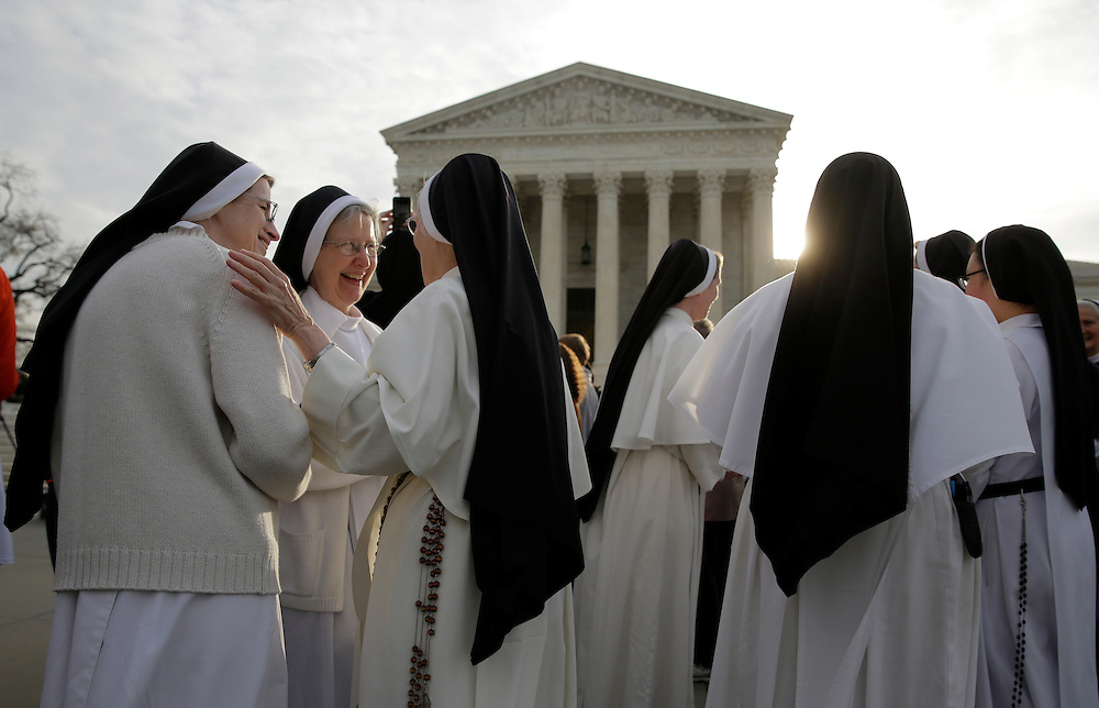 Nuns speak to each other before Zubik v. Burwell, an appeal brought by Christian groups demanding full exemption from the requirement to provide insurance covering contraception under the Affordable Care Act, is heard by the U.S. Supreme Court in Washington March 23, 2016.      REUTERS/Joshua Roberts