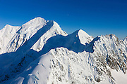 The three-quarters moon is visible over Mount Tasman, a 11476 foot (3498 meter) mountain in New Zealand's Southern Alps. Tasman, called Horo-Koau in Māori, is New Zealand's second-highest mountain. It sits on the South Island's Main Divide.
