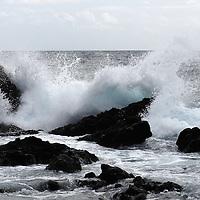 rough seas and big waves break into the coastal rocky shoreline of pico&amp;#xA;Pico Island, Azores Islands, Portugal, North Atlantic Ocean&amp;#xA;&copy; KIKE CALVO / V&amp;W&amp;#xA;( Climate weather storm winds dangerous surf)<br />