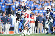 Ole Miss' Brandon Bolden (34) runs past Kentucky's Winston Guy (21) at Commonwealth Stadium in Lexington, Ky. on Saturday, November 5, 2011. ..
