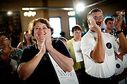 Supporters greet GOP Presidential candidate Rep. Michele Bachmann at a town hall event in Muscatine, Iowa, July 24, 2011.