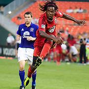 DC Forward Joseph Ngwenya in the air after stricking ball towards the during MLS International friendly match between Everton FC of England and DC United. ..Everton FC Defeated DC United 3-1 Saturday, July 23, 2011, at  RFK Stadium in Washington DC.