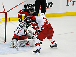 Apr 15, 2009; Newark, NJ, USA; New Jersey Devils left wing Zach Parise (9) shoots on Carolina Hurricanes goalie Cam Ward (30) during the first period of game one of the eastern conference quarterfinals of the 2009 Stanley Cup playoffs at the Prudential Center.