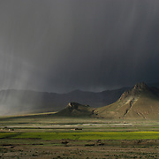 A storm rolling in over the Tibetan countryside. 8/9/05. It is feared that this vast, unspoiled landscape, sacred to Tibetans, will be exploited for its mineral wealth now that the high speed rail line from China to Tibet has been completed.