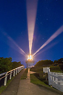 Beams from the Smoky Cape Lighthouse in the twilight sky, beaming out beside the stars of the Southern Cross and the Pointers (Alpha and Beta Centauri) below, rising into the southeast sky in the deepening blue twilight. <br /> <br /> The Lighthouse is near South West Rocks on Trial Bay on the coast of NSW, Australia. The lighthouse has a pattern of three closely spaced beams followed by a longer gap. The lenses project three sets of three beams, one set shooting here toward the camera, and two others shooting away from the camera out to sea.<br /> <br /> This is a single 0.6-second exposure at f/2.8 with the 35mm lens and Canon 6D at ISO 6400.