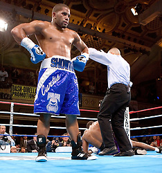 February 16, 2006 - New York, NY - Super middleweight Curtis Stevens poses as the referee counts out Jose Spearman during the 2nd round of their 10 round bout at the Manhattan Center in New York.