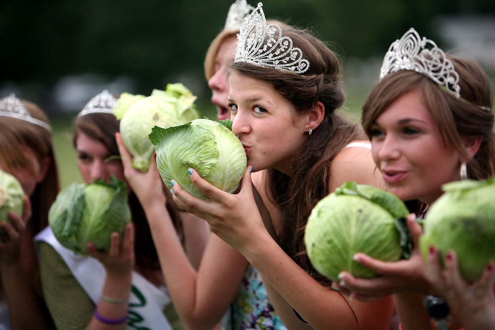 Miss Henderson 2012 Savannah Zippel, second from right, casts a sideways glance as the royal court poses for a photo at the cabbage toss during Sauerkraut Days in Henderson, MN, June 23, 2012.