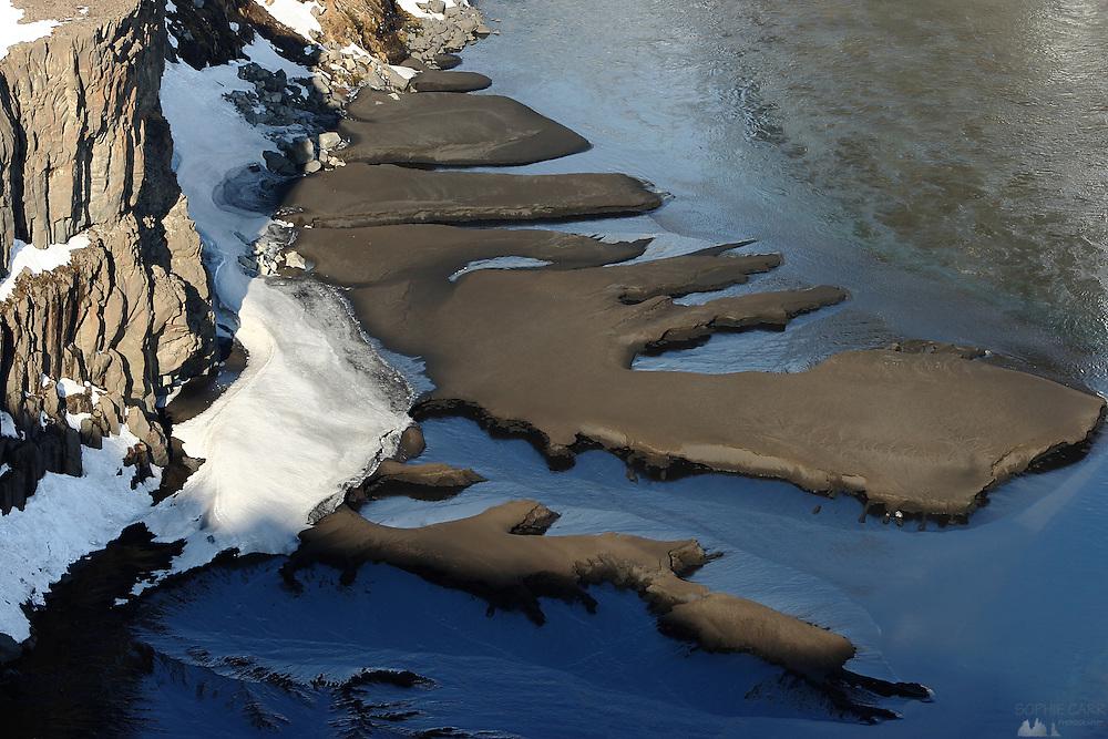 Frozen water on the Jökulsá á Fjöllum river, just downstream from the Hafragilfoss Waterfall