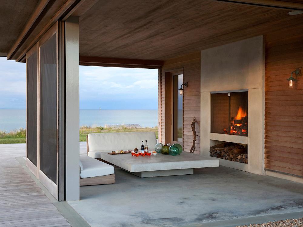 Martha's Vineyard house. Outdoor patio and fireplace. Architect: Claudia Noury-Ello. Designer: Christine Lane Interiors