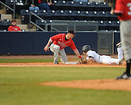 Ole Miss's Tim Ferguson steals third base vs. Arkansas State at Oxford-University Stadium in Oxford, Miss. on Tuesday, February 23, 2010. Ole Miss won 3-2.