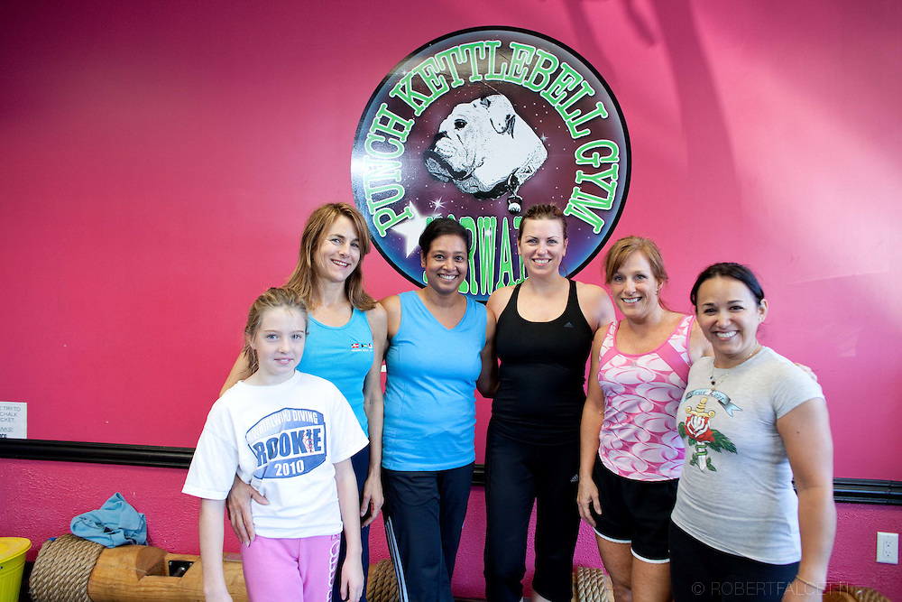 NORWALK, CT- 11 November  2010:  Punch Kettlebell Gym Norwalk photographed for HealthyLifeCT magazine. From left Amanda Pyne and her mother Karen Pyne from Greenwich, Shamala Fazio from Wilton, Paige Klein from Norwalk, Maureen Hines from Westport and Mabel Prada from Stamford. (Photo by Robert Falcetti)..EDS NOTE: Men are Jaakob Gore from New Canaan (green shirt) and Steve Defala from Norwalk (blue shirt). .