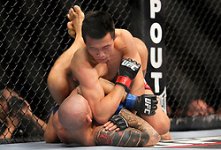 Fairfax, VA - May 15, 2012: Dustin Poirier (Blue trunks) and Chan Sung Jung (White trunks) during the UFC on FUEL TV 3  main event at the Patriot Center in Fairfax, Virginia.