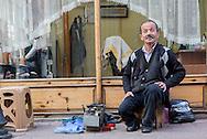 A shoeshine outside a barber shop in Inebolu.