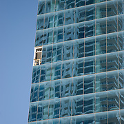 A window missing from a skyscraper along The Strip in Las Vegas due to construction provides a sesnse of isolation and danger.