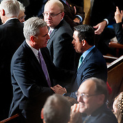 House Majority Whip Kevin McCarthy (R-CA) chats with Rep. Michael Grimm (R-NY) before the start of the 113th Congress on Thursday, Jan. 3rd, 2013 in Washington. (Photo by Jay Westcott/Politico)