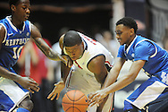 "Mississippi's Martavious Newby (1) is fouled by Kentucky's Ryan Harrow (12) as Kentucky's Archie Goodwin (10) also defends at the C.M. ""Tad"" Smith Coliseum on Tuesday, January 29, 2013.  (AP Photo/Oxford Eagle, Bruce Newman).."
