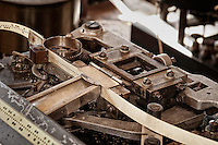Paper tape feeder on the Kleinschmidt Perforator. The Kleinschmidt was similar to a typewriter but instead of print it generated the Morse code dots and dashes for a character in one stroke. 1 to 4 holes as required