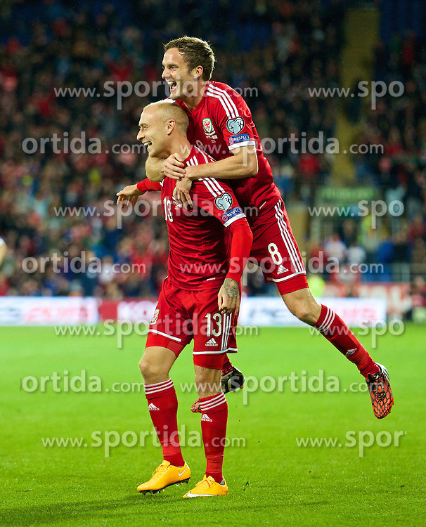 13.10.2014, City Stadium, Cardiff, WAL, UEFA Euro Qualifikation, Wales vs Zypern, Gruppe B, im Bild Wales' David Cotterill celebrates scoring the first goal against Cyprus with team-mate Andy King // 15054000 during the UEFA EURO 2016 Qualifier group B match between Wales and Cyprus at the City Stadium in Cardiff, Wales on 2014/10/13. EXPA Pictures &copy; 2014, PhotoCredit: EXPA/ Propagandaphoto/ David Rawcliffe<br /> <br /> *****ATTENTION - OUT of ENG, GBR*****
