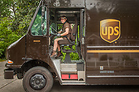 """UPS delivery person Chantal Cook on Myrtle Street in Calistoga.  """"I live in Middletown but I deliver all over...Calistoga is my favorite...I love the mountains."""""""