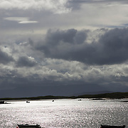 Silhouette of boats anchored off Achill Island, County Mayo, Ireland.