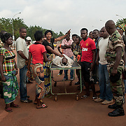 November 16th, a FACA soldier (national army during the previous government) was thrown dead in front of the Parliament by the Seleka. Family and brothers in arms show their anger by taking the body from the morgue onto one of the main streets of Bangui.