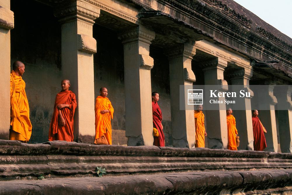 Monks behind the columns of the gallery at Angkor Wat, Angkor, Cambodia
