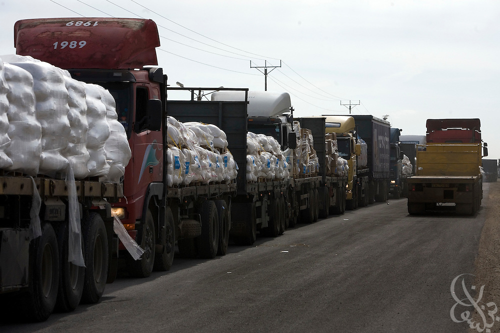 United Nations Aid shipments sit atop trucks cued at the Karem Shalom border crossing with Gaza January 8, 2009. The United Nations announced it was halting shipments of aid into Gaza today after one of its' drivers was fired on and killed by Israeli forces as he drove to pick up aid shipments on the Gaza side of the border.