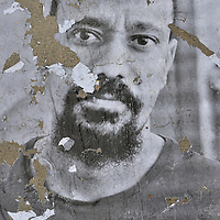 Portrait of a refugee seeking asylum in Switzerland, defaced during an exhibition, and so showing directly the hand of prejudice and rejection. The original series was produced as part of an anti-racism week, in cooperation with the New York-based Insideout Project, who produced the one meter prints and which were pasted in a public square by the refugees themselves, many of whom were living - and photographed - in underground bunkers. The exhibition had to be removed following the damage, but not before this new series of images were taken, and which echo something of the global refugee experience in  present times. Portraits include people seeking asylum from countries as diverse as Togo, Mali, Guinea, Ghana, Sudan, Eritrea, Somalia, Algeria, Afghanistan, India, Pakistan, Sri Lanka, Iraq and Syria.