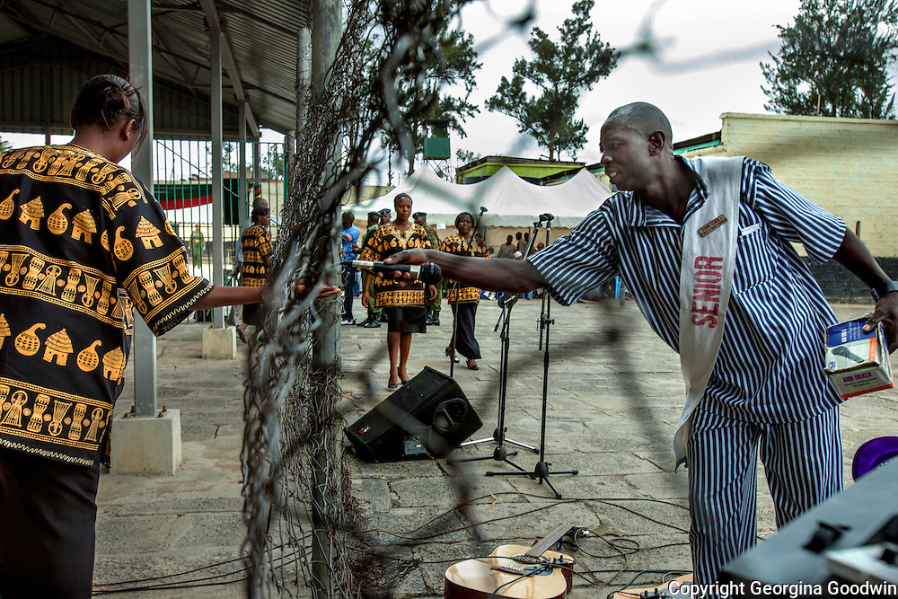 Guards check the main entrance door at Nairobi Remand and Allocation Prison during celebrations being held for International Day of the Gifted under a programme called Talent Behind Bars at Nairobi Remand and Allocation Prison in the city's industrial area, built in 1911 by the British during the colonial period. Participants and inmates came from the Remand and Allocation Prison, Kamiti Main and Medium Prisons and Langata Women's Prison. 10 August 2012