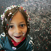 "Noelle Amiry, 7, from Johnston, Iowa, helped bring in the new year at the Science Center in Des Moines, Iowa, in 2006.  She celebrated along with about 1,000 others during 'Happy Noon Year""."
