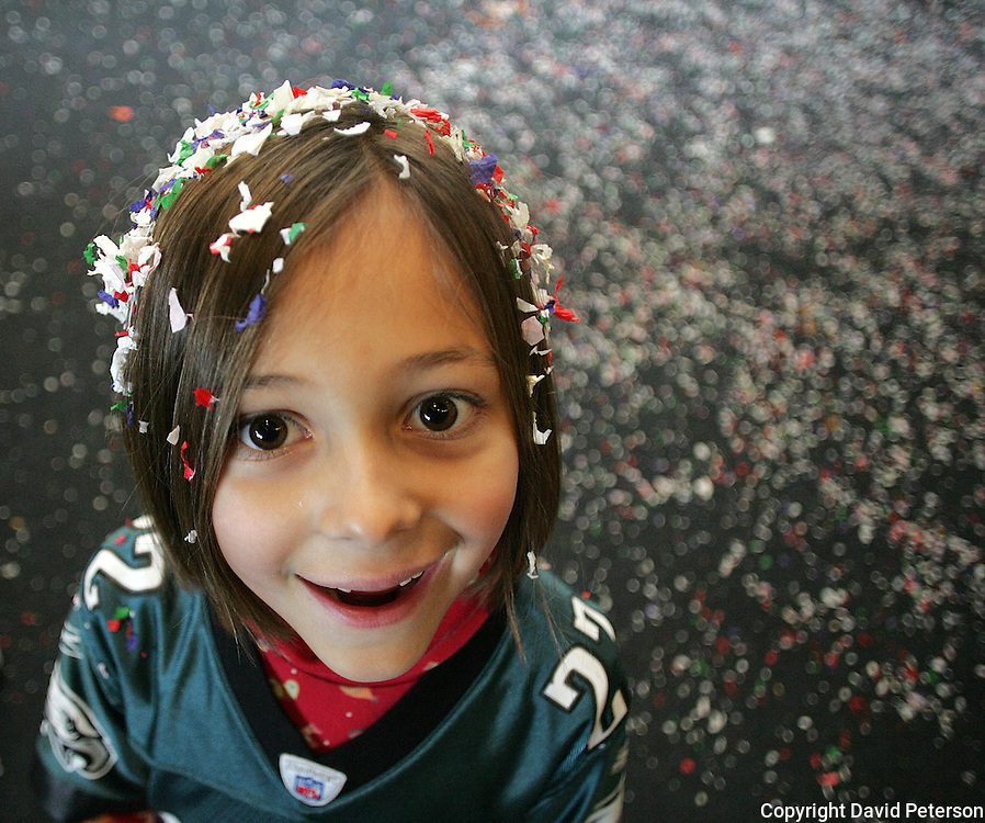 """Noelle Amiry, 7, from Johnston, Iowa, helped bring in the new year at the Science Center in Des Moines, Iowa, in 2006.  She celebrated along with about 1,000 others during 'Happy Noon Year""""."""