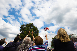 London, August 15th 2015.  Dozens of people watch as a Douglas DC 3 Dakota, a Hurricane and a Eurofighter Typhoon fly over Horseguards Parade, marking the start of a Drumhead ceremony to mark the 70th anniversary of VJ Day.
