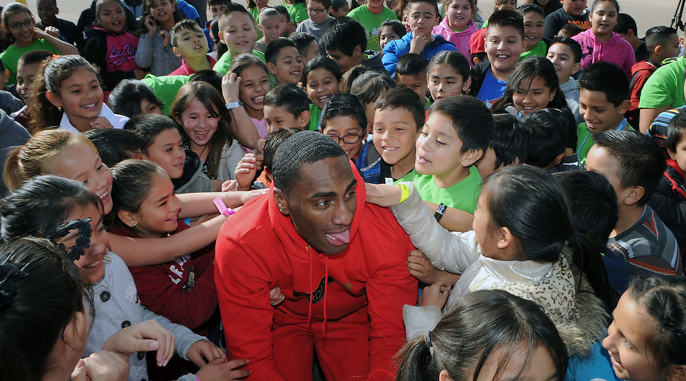 jt030317a/a sec/jim thompson/Olympic silver medalist (2012)Erik Kaynard is surrounded by students at Wherry Elementary School at the start of the USATF RunJumpThrow experience Friday morning in Albuquerque, NM.  Friday March 03, 2017. (Jim Thompson/Albuquerque Journal)