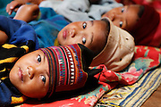 Ethnic hill tribe children at mountain schoolhouse take a nap.