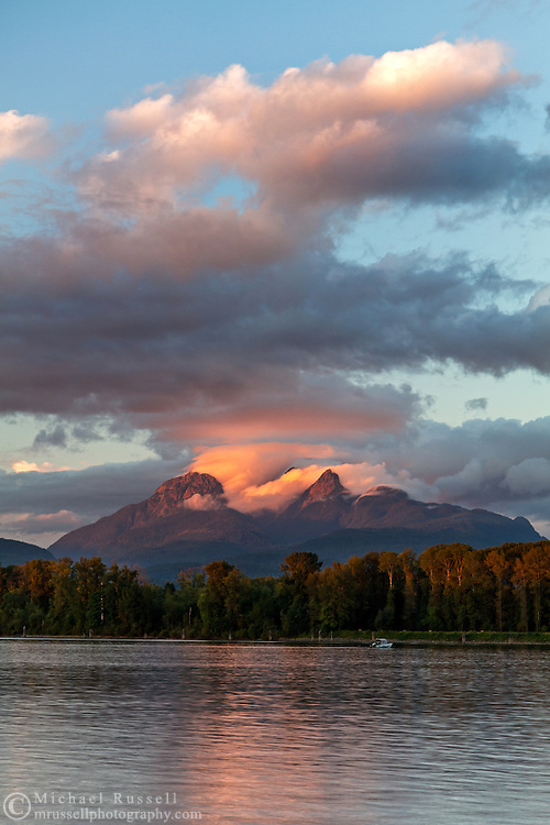 The Golden Ears (Mount Blandshard) and the Fraser River at sunset from Brae Island Regional Park in Langley, British Columbia, Canada