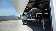 The Boeing 40 being pushed out of the hangar.