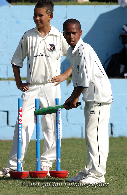 Bermuda youth cricket players on the pitch during the first day of Cup Match at the St. George's Cricket Club in St. George's, Bermuda on Thursday, July 28, 2011. The 109th. Annual Cup Match takes place during the two day public holidays of Emancipation Day and Somers Day in Bermuda.